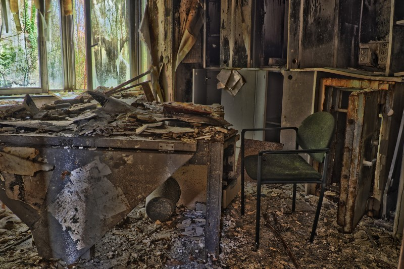 Demolished room with chair and desk