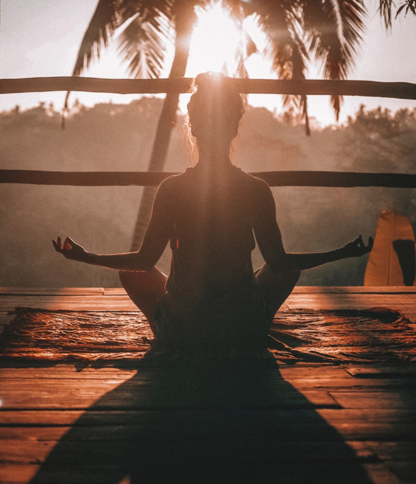Woman meditating in Bali