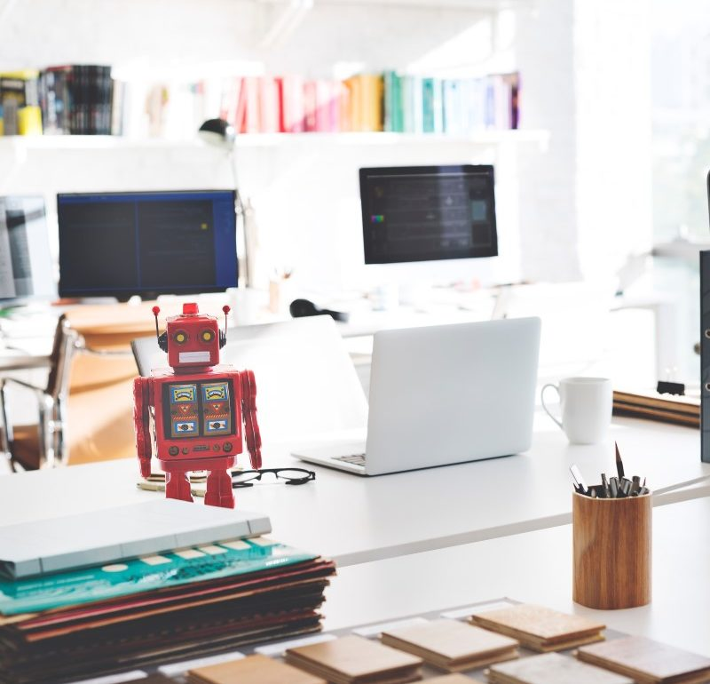 robot in office with computers