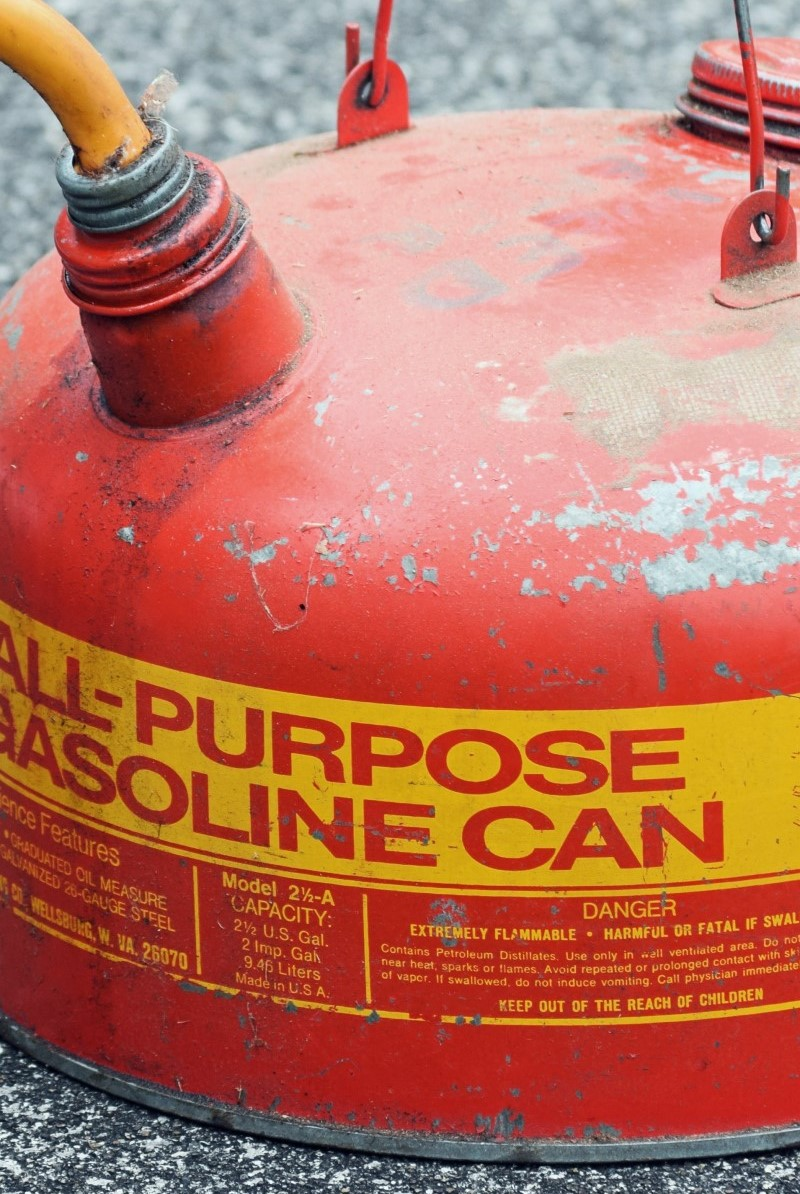 all-purpose gasoline can, red and yellow and old and dirty