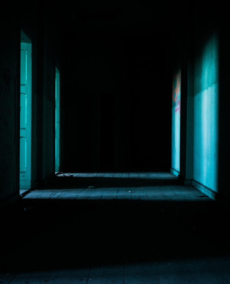 dark corridor with doors