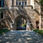 Yale University doorway arch of old brick building with wrought iron door