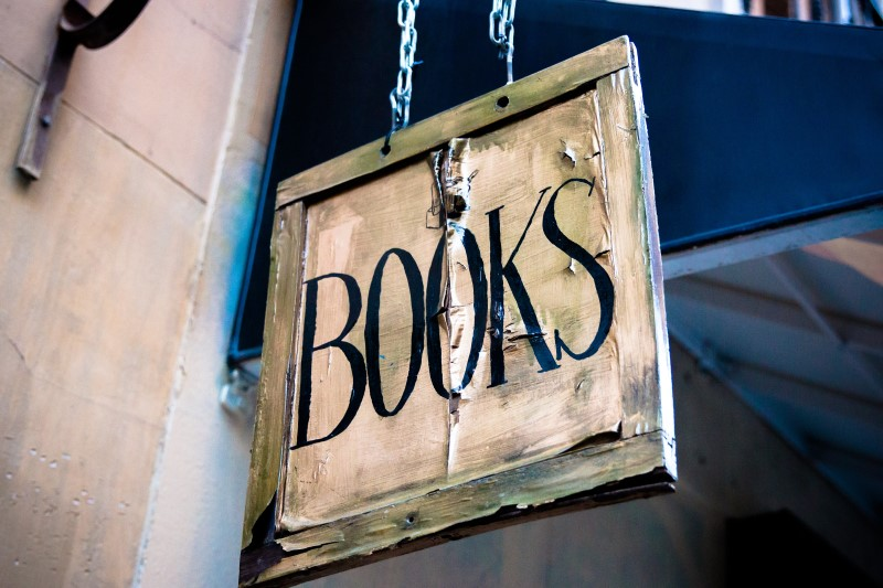 old bookshop sign that says BOOKS