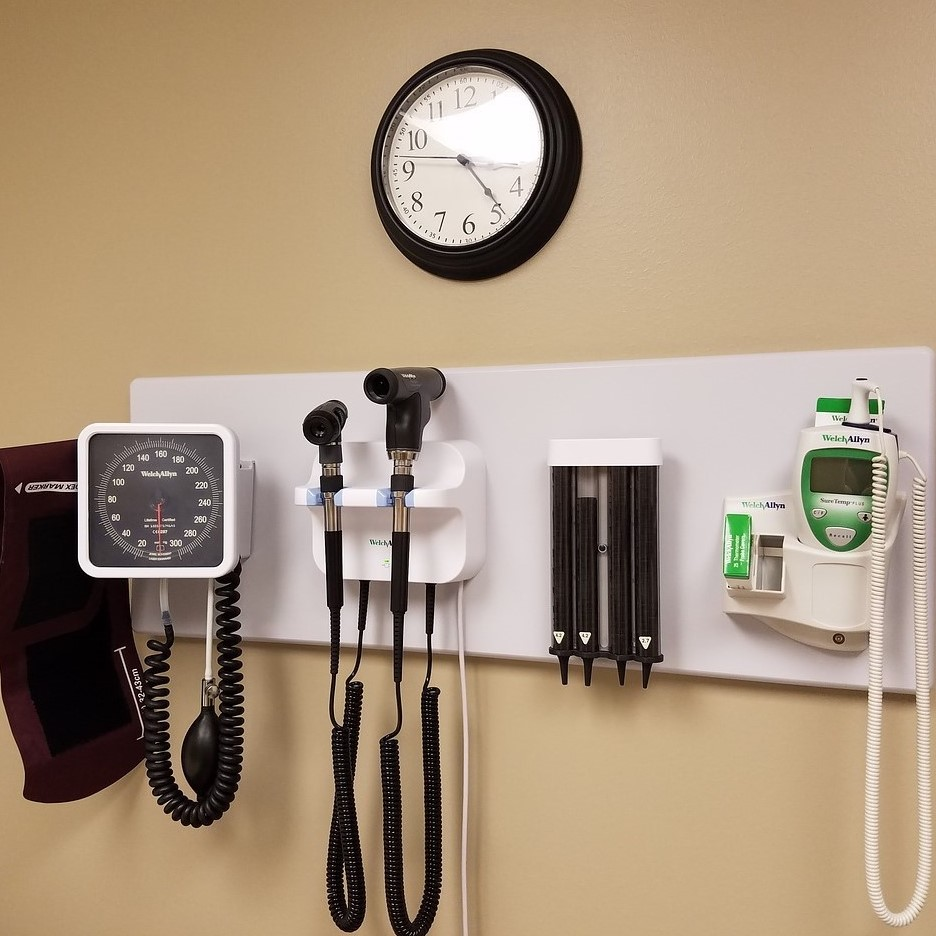 doctor's office with medical supplies and clock
