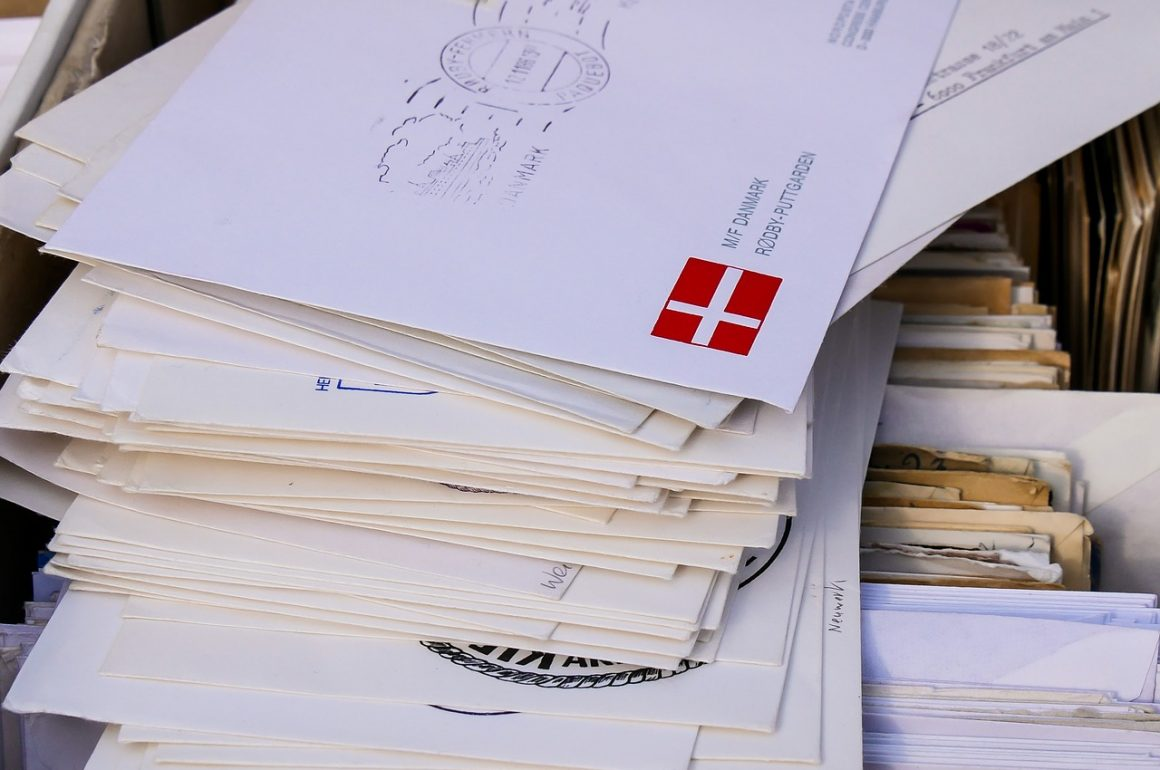 large stack of envelopes and mail