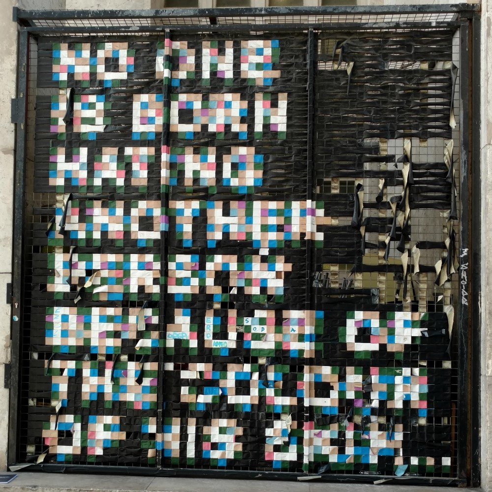 Artwork that says NO ONE IS BORN HATING ANOTHER PERSON BECAUSE OF THE COLOUR OF HIS SKIN...