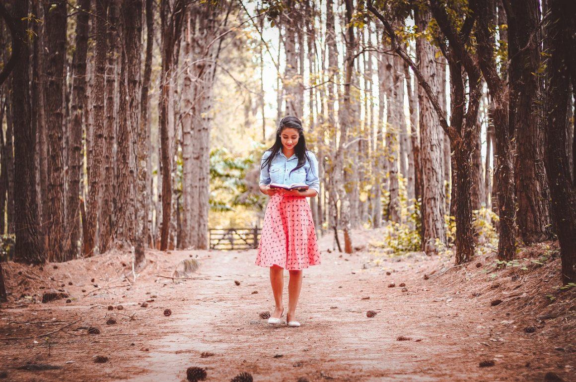 woman reading while walking