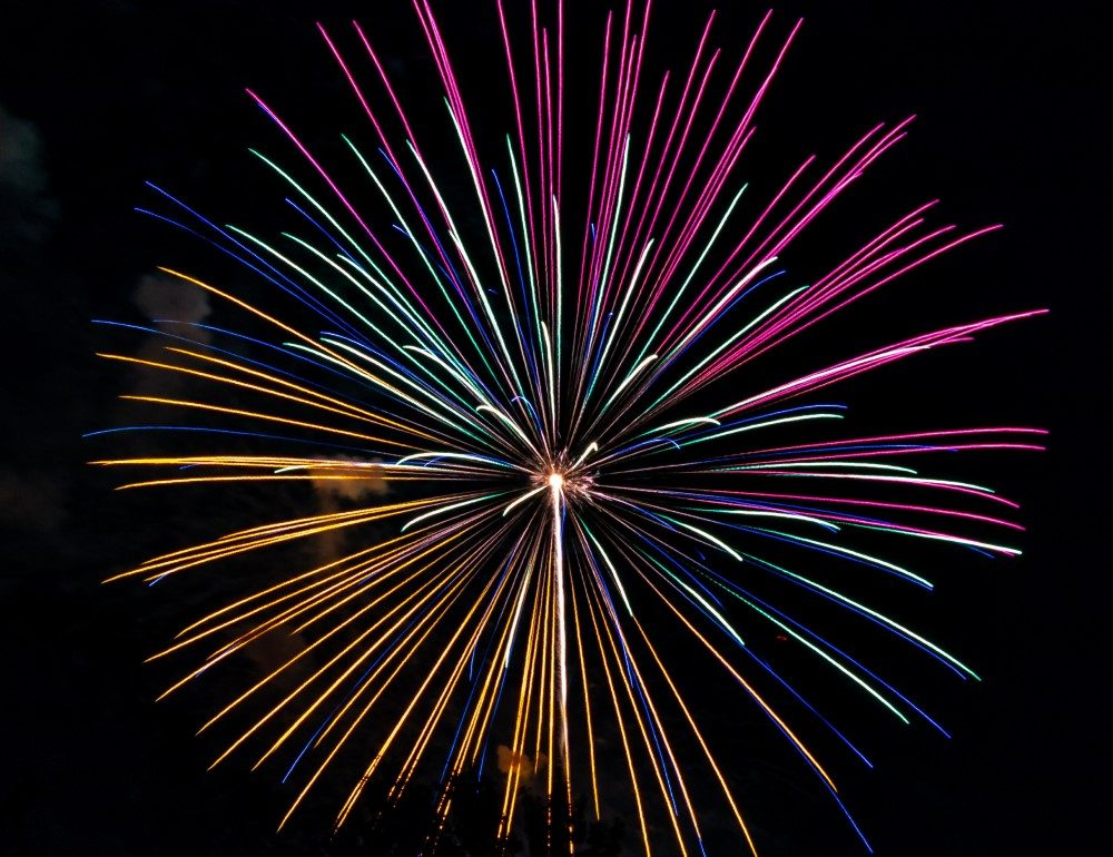 one giant pink and yellow and blue firework - let's celebrate 2020 - happy new year