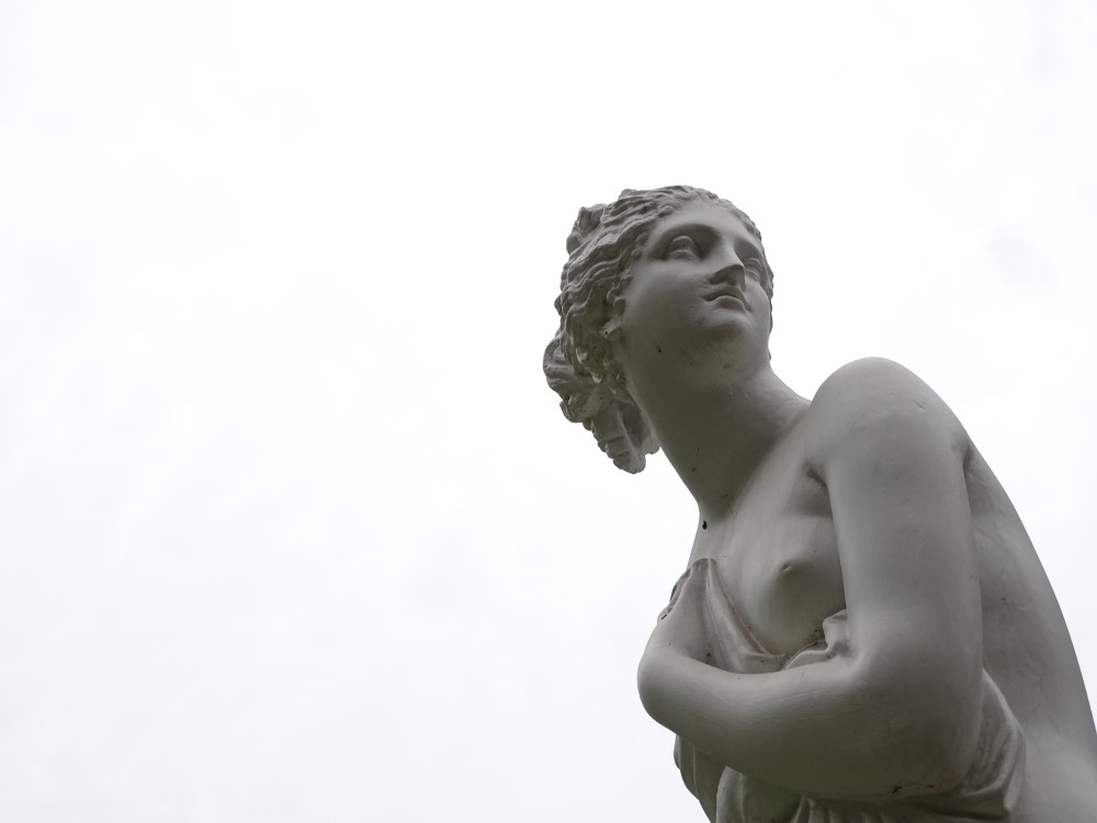 statue of woman against gray sky