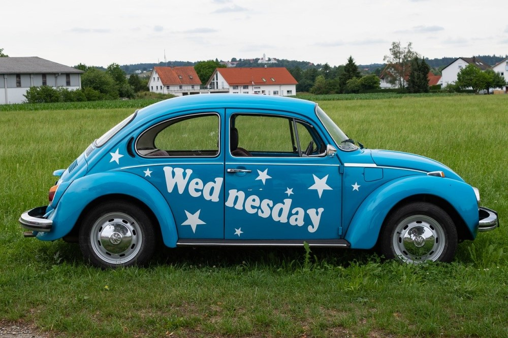 VW beetle painted with the word Wednesday