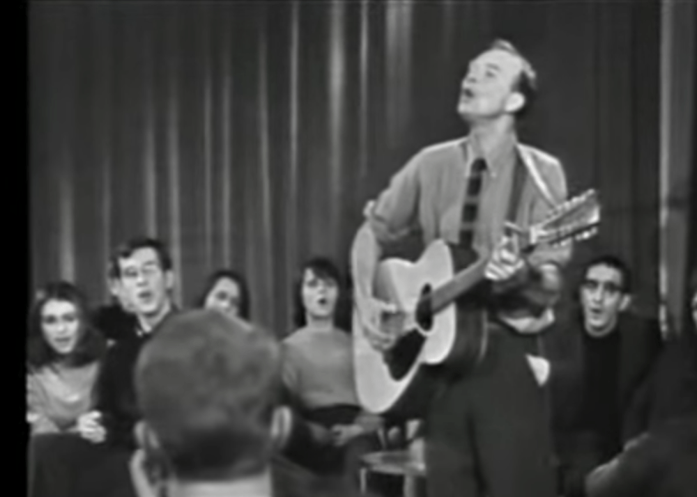 Pete Seeger singing with guitar in 1967