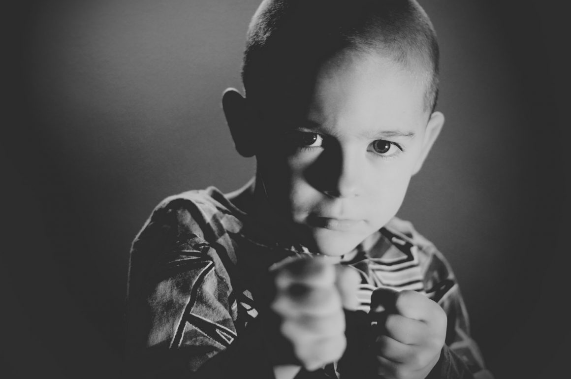 boy with fists up showing a fighting spirit