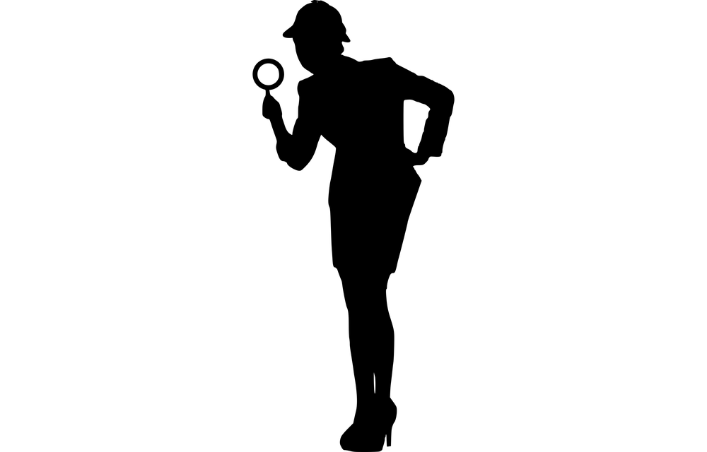 Woman with detective hat and magnifying glass