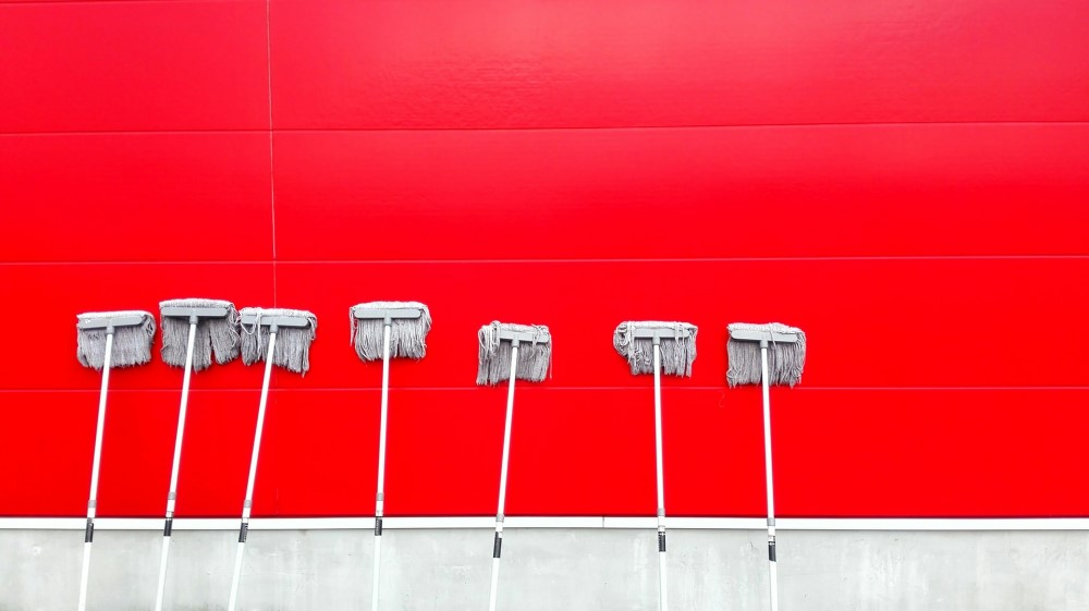 mops on red wall