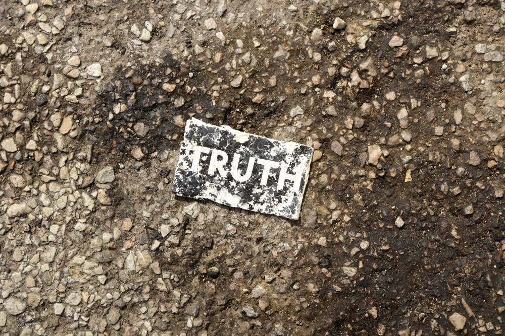 the word TRUTH on a card on the pavement found on a parking lot along Interstate 294 outside Chicago