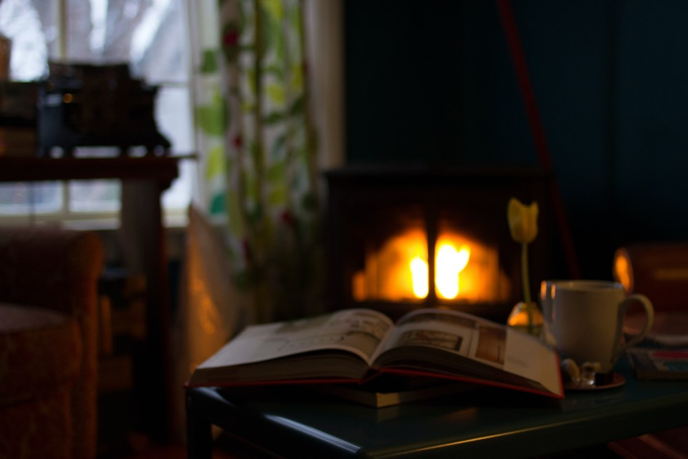 open book by cozy fire