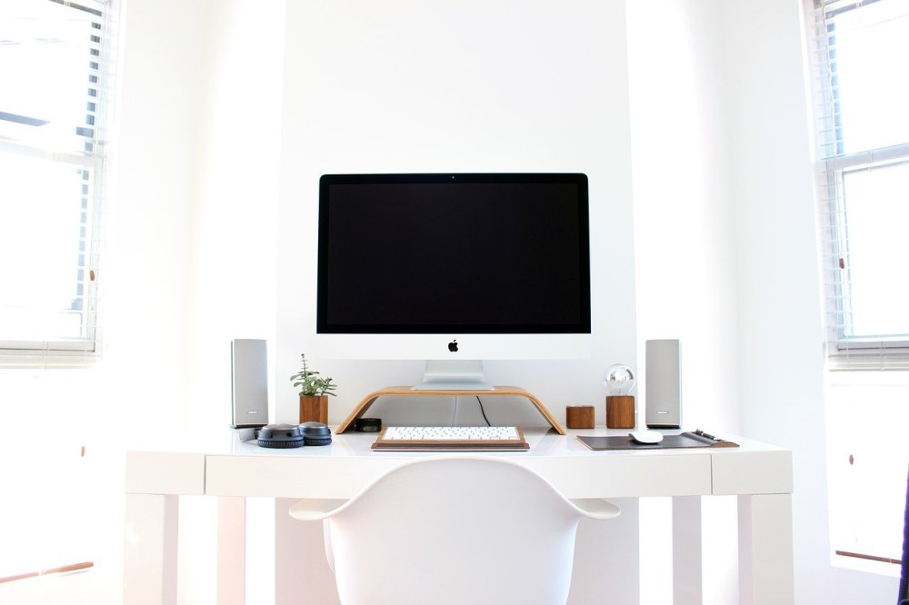 Apple computer in white room