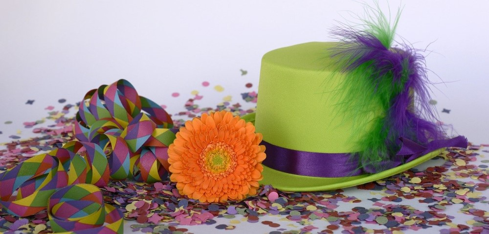 party confetti with ribbon and flower and hat