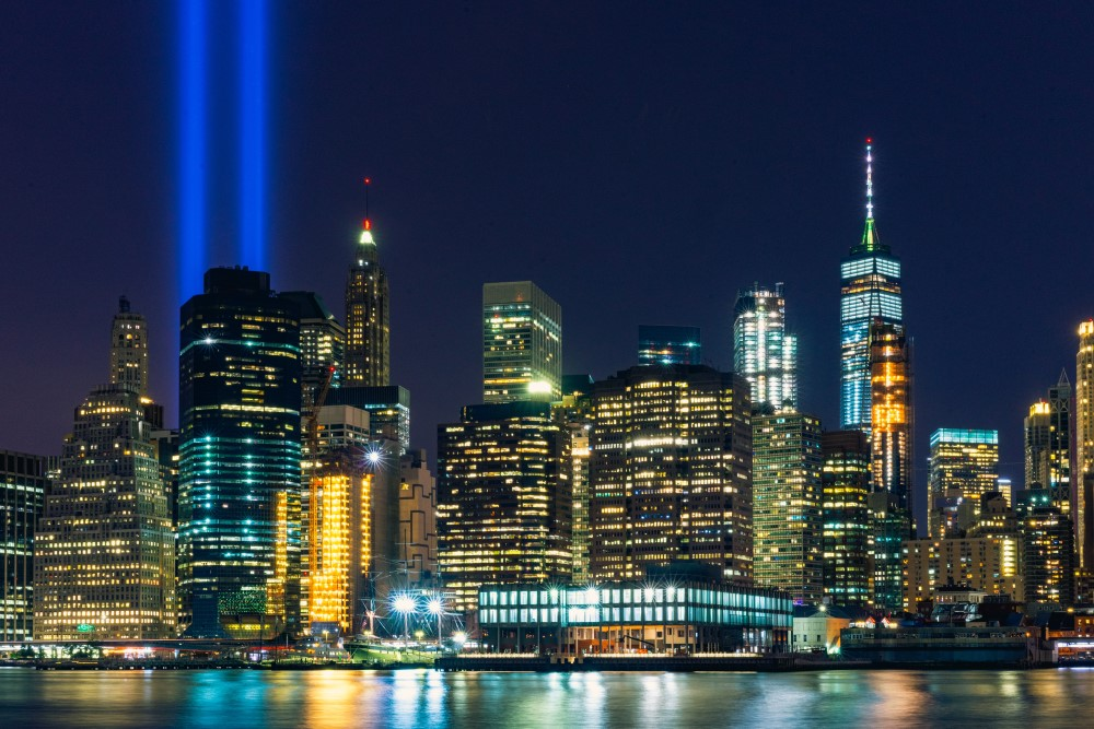New York City at night with lights for twin towers
