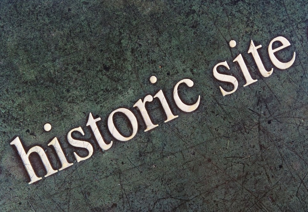 the words historic site made to look like a plaque at a historic site